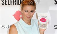 Maria Sharapova poses at a Photocall to launch her new range of Candy 'Sugarpova' at Selfridges June 20, 2013