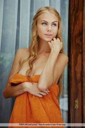Blonde babe Nancy on an orange blanket (Femjoy)