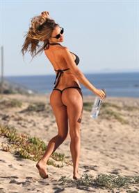 Charlie Riina in a bikini - ass