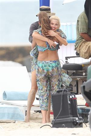 Minka Kelly and Rachael Taylor hug while filming Charlie's Angels on a beach in Miami 02-09-11