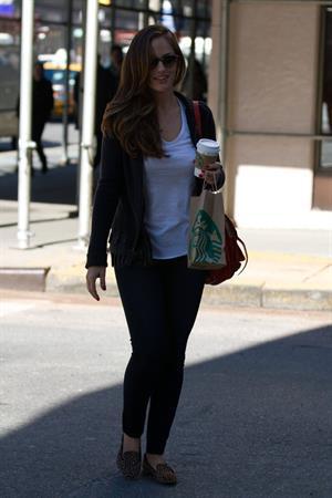 Minka Kelly outside her hotel with her morning Starbucks in New York City 8/2/2012