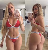 Amanda Elise Lee in a bikini taking a selfie and - ass