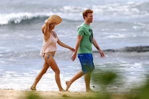 Pamela Anderson Takes a walk in bikini bottoms on the Island of Maui December 30, 2012