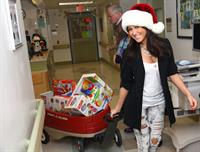 Adrienne Bailon visits children at the Beth Israel Medical Center in New York