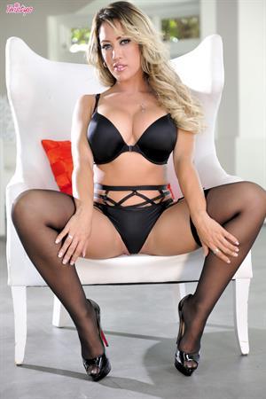 Capri Cavanni Twistys treat of the month for December 2014 - solo in black lingerie