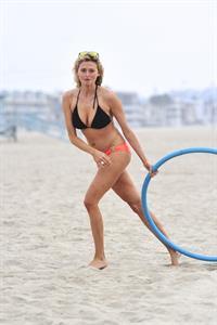 Estella Warren in a bikini with a hula hoop in Venice Beach on August 12, 2014