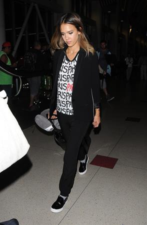 Jessica Alba arriving at LAX August 05, 2014