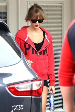 Taylor Swift wearing shorts and a  Pink  jacket in Los Angeles 10/27/13