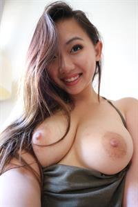 Harriet Sugarcookie taking a selfie and - breasts