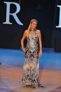 Paris Hilton walks for designer duo Shane and Falguni Peacock and performs as a DJ at the India Resort Fashion Week