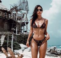 Nicole Isaacs in a bikini