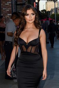 Demi Rose Mawby sexy cleavage and ass in a tight black dress.