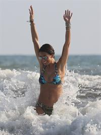 Elisabetta Gregoraci sexy thong bikini showing her sexy ass and cleavage at the beach seen by paparazzi.