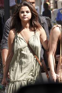 Selena Gomez braless and sexy in a dress seen by paparazzi in Rome.
