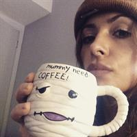 Sarah Shahi taking a selfie