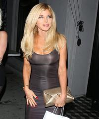 Donna D'Errico braless boobs in a see through dress showing off her tits seen by paparazzi.