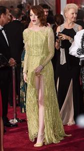 Emma Stone upskirt wardrobe malfunction on the red carpet showing her legs and panties caught by paparazzi.