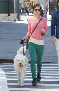 Olivia Wilde walking her dog with a friend in New York City - April 8, 2013