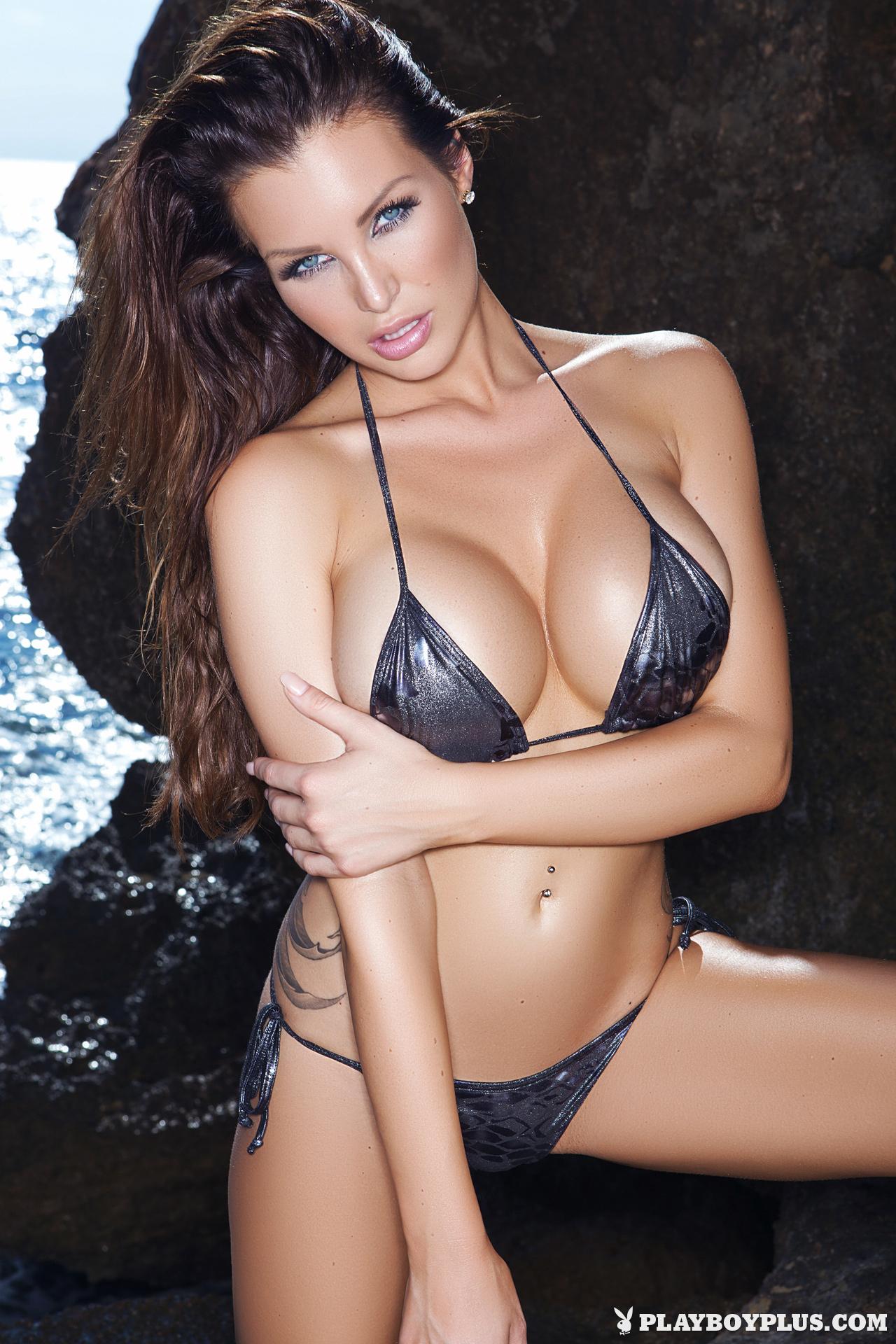 Playboy Cybergirl Helen de Muro posing on rocks