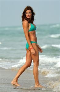 Kelly Bensimon in a bikini - ass