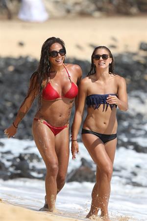 Alex Morgan and Sydney Leroux in bikinis on the beach in Hawaii
