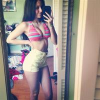 Angie Varona in a bikini taking a selfie