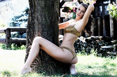 Avia Fenestra in a bikini - ass