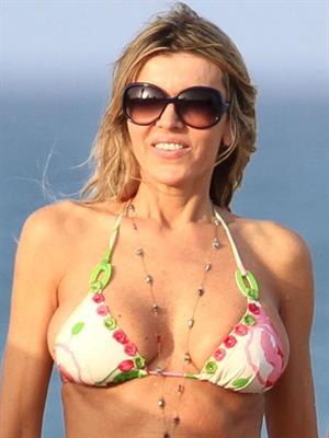 Rita Rusic in a bikini on the beach
