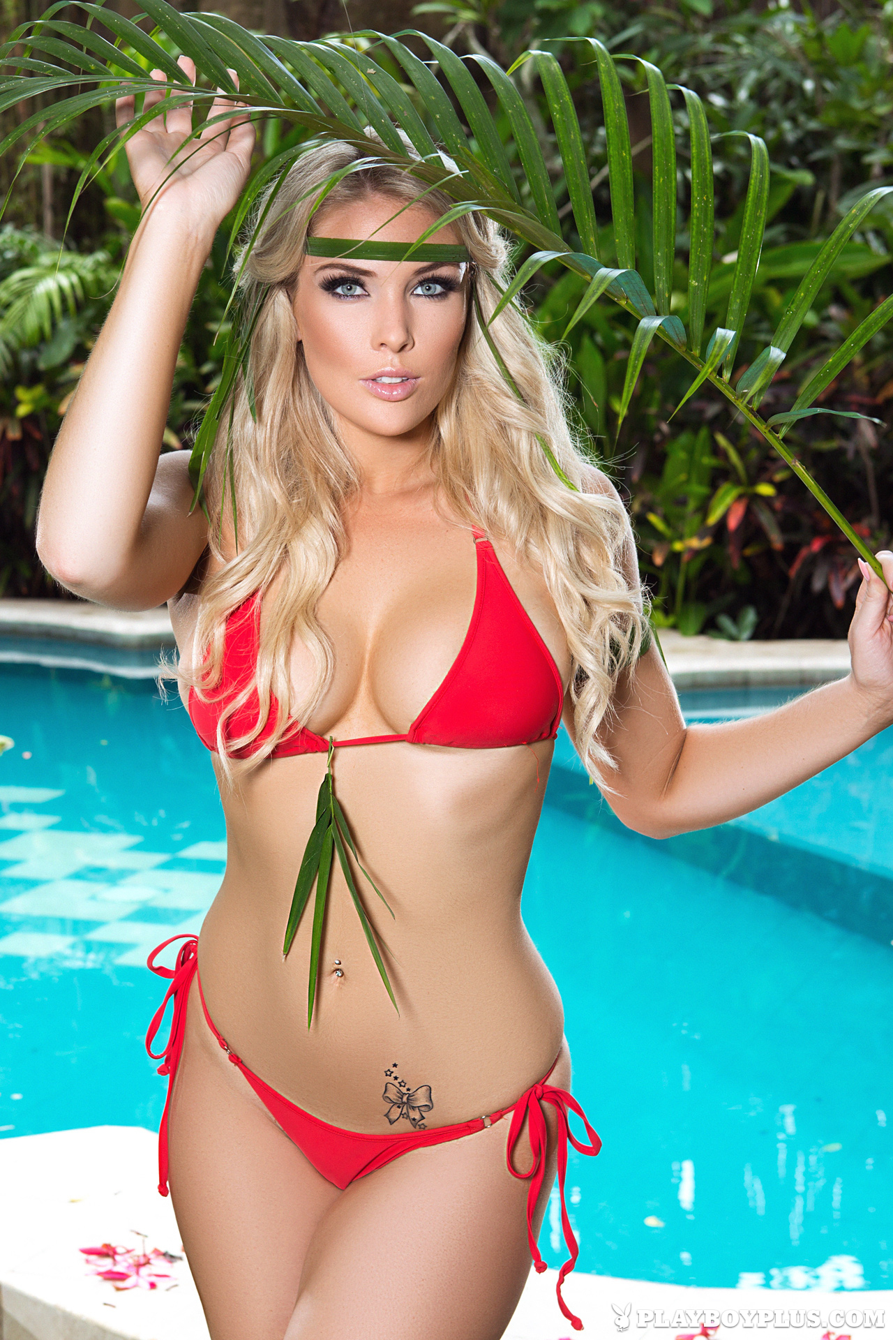 Playboy Cybergirl - Rebekah Cotton takes off red bikini by a pool